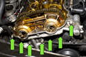 Remove the seven 10mm VANOS actuator fasteners (green arrow).