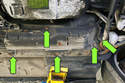 Remove the five fuel filter cover mounting fasteners, and then remove the fuel filter cover (green arrows).