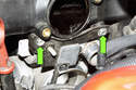 Remove the idle air valve T-40 Torx fasteners (green arrows).