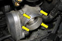 Remove the four 10mm throttle housing fasteners (yellow arrows) then the remove throttle housing from the engine.