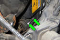 To adjust, rotate adjuster (yellow arrow) located at the end of the throttle cable housing.