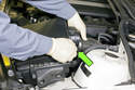 Loosen the air flow meter clamp (green arrow), then disconnect the duct from air flow meter and remove the air filter housing from the engine compartment.