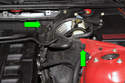 Rotate the panel clips 90 degrees counterclockwise to release (green arrows).