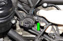 Then disconnect the canister connection hose by squeezing the release tab and pulling off the solenoid (green arrow).