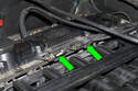 Working at the top of the intake manifold, locate the oxygen sensor connectors (green arrows).