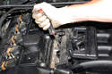 Then release the fuel injector harness strip from the fuel injectors and remove.