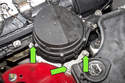 Next, remove the three 10mm secondary air pump fasteners (green arrows).