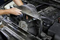 Unscrew the viscous coupler from the coolant pump and remove it from the engine compartment with the fan shroud.