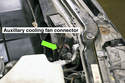 Working in engine compartment, disconnect the cooling fan electrical connector.
