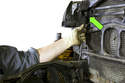 When installing, feed the electrical connector through the opening in the radiator support.