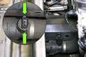 On the side of the sensor, there are two tabs you squeeze to release it from the lower radiator hose (green arrows).