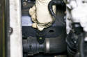 Squeeze sensor release tabs and remove it from lower radiator hose.