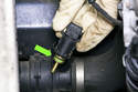 When removing, check that the sealing o-ring does not remain in lower radiator hose (green arrow).
