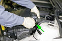 Loosen the air flow meter clamp (green arrow), then disconnect the duct from the air flow meter and remove the air filter housing from the engine compartment.