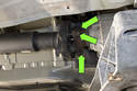 Next, working at the transmission flange side, remove the three driveshaft flex disc mount fasteners (green arrows).