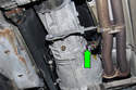 Working at side of the transmission, remove the fill plug (green arrow).
