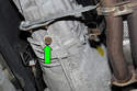 Place the drain pan under the transmission and remove the fluid drain plug (green arrow).