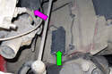 Working from behind the front strut (purple arrow), open the plastic door (green arrow) for the brake pad wear sensor electrical connector.