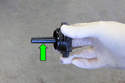 Before starting engine, fill the power steering reservoir with clean fluid to the MAX level on dipstick (green arrow).