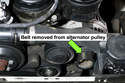 Remove the engine drive belt from alternator pulley and lay aside.