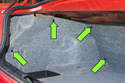 Start in the trunk and locate the four interior trim clips (green arrows).
