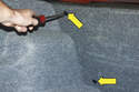 Using a flathead screwdriver, remove the trim clips by them rotating 90 degrees counterclockwise and pulling them away from the body (yellow arrows).