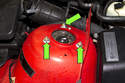 Next, remove the upper strut mounting nuts and remove the strut from the vehicle (green arrows).
