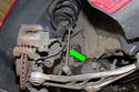 ThisPicture shows the stabilizer link (green arrow) connecting o the vehicle stabilizer bar to the front strut.