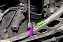 Working at the front stabilizer bar, remove the stabilizer link nut (green arrow) by counter-holding the link (purple arrow) with a 15mm or 16mm wrench and loosening the 16mm nut.