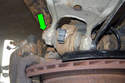 Remove the rear ball joint 18mm fastener.