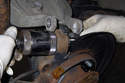 Assemble the ball joint tool to extract the ball joint from the wheel bearing carrier.