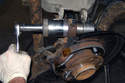 Assemble the ball joint tool and the new ball joint to install the ball joint into the wheel bearing carrier.