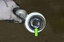 Apply a liberal amount of tire lube or dish soap to inside of bushing (green arrow).