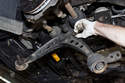Swing the control arm down and remove the final ball joint fastener.