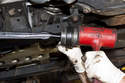 Then tap the bushing onto the control arm using a soft-faced hammer.