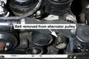 Remove the engine drive belt from the alternator pulley and lay it aside.