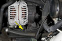 Working below the alternator, disconnect the cooling duct (yellow arrow).