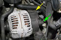 Working at the back of the alternator, disconnect the electrical connector (yellow arrow).