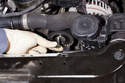 Slide the bolt out of the alternator and remove the pulley from the engine.