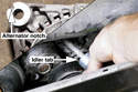 Install the idler pulley through the alternator and fasten it to engine.