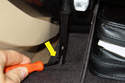 With your glove box still open, remove the suspension strut rivet located on the left side of your glove box then detach the strut from your glove compartment (yellow arrow).