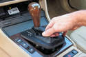 Pull up on the shifter bezel (automatic transmission) or shift boot (manual transmission) (depending on equipment) to unclip from the center console.