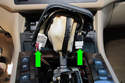 Automatic transmission: Disconnect the shifter bezel electrical connectors (green arrows).