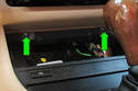 Remove the trim panel fasteners (green arrows).