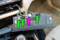 Disconnect the IHKA panel electrical connector by releasing the lever lock and rotating it up and pull the connector out of the panel (purple arrow).