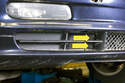 Start working at the left and right lower corners of the bumper.
