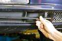 To remove the trim piece, grasp firmly on the inside edge and pull it out of the bumper cover - this mat might require a little wiggling.