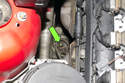 Working in the engine bay, locate the top of the right engine mount.