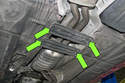 Next, working at the center of your exhaust, remove ten 13mm exhaust bracket fasteners (green arrows).