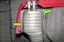 Remove the four 13mm muffler mounting fasteners and lower the exhaust enough to access the tailpipe flap (green arrows).